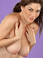 Kym shows off her large natural breasts from Ambya